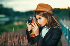 Beautiful hipster girl shooting Royalty Free Stock Photo