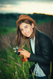 Beautiful hipster girl shooting Royalty Free Stock Images
