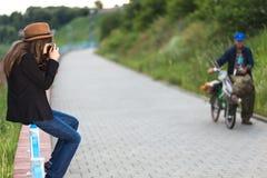 Beautiful hipster girl shooting Stock Photo