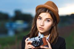 Beautiful hipster girl shooting Royalty Free Stock Photos