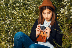 Beautiful hipster girl shooting Royalty Free Stock Photography