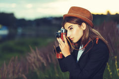 Beautiful hipster girl shooting Stock Photos