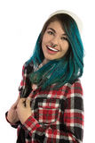 Beautiful hipster girl smiling with fun. On white background. Pierced, turquoise haired and dressing up a plaid shirt Royalty Free Stock Photography