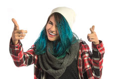 Beautiful hipster girl smiling while indicating you. On white background. Pierced, turquoise haired and dressing up a plaid shirt Stock Image