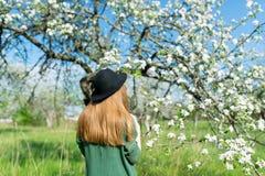 Beautiful hipster girl in spring garden. stock photos