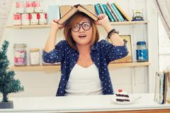 Beautiful hipster woman cover her head with book, afraid of some. Thing falling background Stock Photos