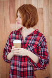 beautiful hipster woman holding a coffee cup Royalty Free Stock Image