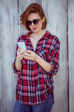 Beautiful hipster woman looking at her mobile phone Royalty Free Stock Images