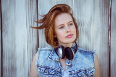 beautiful hipster woman wearing headphones and looking into the distance Stock Photography