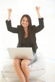 Beautiful hispanic business female with laptop excited.  Stock Photos
