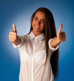 Beautiful hispanic business woman gesturing success shownig thum Royalty Free Stock Photo