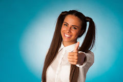Beautiful hispanic business woman gesturing success shownig thum Stock Photography