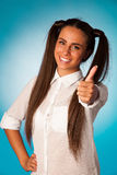 Beautiful hispanic business woman gesturing success shownig thum Royalty Free Stock Photos