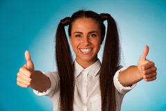 Beautiful hispanic business woman gesturing success shownig thum Stock Images