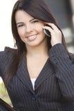 Beautiful Hispanic Businesswoman Using Cell Phone Royalty Free Stock Photography