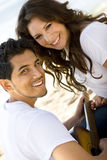 Beautiful Hispanic couple laughing and smiling. Stock Photos