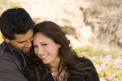 Beautiful Hispanic couple laughing and smiling. Stock Photo