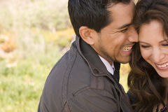 Beautiful Hispanic couple laughing and smiling. Stock Images