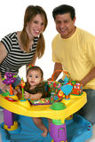 Beautiful Hispanic Family. Hispanic parents with baby girl playing with toys. Ages 3 months, 20 years, 45 years Stock Photos