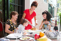 Beautiful hispanic family enjoying an outdoor home meal together Stock Photo