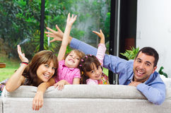 Beautiful hispanic family of four posing with Royalty Free Stock Images