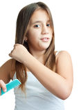 Beautiful hispanic girl combing her hair Royalty Free Stock Image