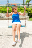 Beautiful hispanic girl riding a swing Royalty Free Stock Images