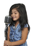 Little Girl Singer. Beautiful hispanic girl singer performing at a concert Royalty Free Stock Image