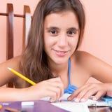 Beautiful hispanic girl studying at home Stock Images