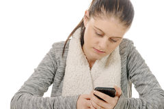 Beautiful hispanic girl texting on her cellphone Royalty Free Stock Images
