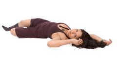 Beautiful hispanic model lying down. An isolated beautiful hispanic model lying on her back looking into the camera Stock Photo