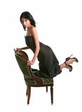 Beautiful Hispanic Model Posing on a Chair Stock Image