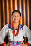 Beautiful hispanic model wearing andean traditional clothing smiling and posing for camera, beige studio curtain Stock Images