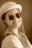 Beautiful hispanic model wearing light colored blouse, trendy sunglasses with matching hat, smiling posing for camera Stock Photography