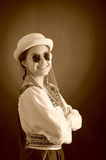 Beautiful hispanic model wearing light colored blouse, trendy sunglasses with matching hat, smiling posing for camera Royalty Free Stock Photos