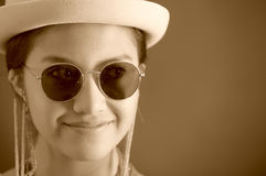Beautiful hispanic model wearing light colored blouse, trendy sunglasses with matching hat, smiling posing for camera Stock Images