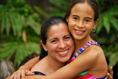 Beautiful Hispanic Mother and Daughter. Embracing Stock Images