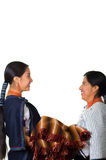 Beautiful hispanic mother and daughter wearing traditional andean clothing, seen from profile angle facing each other Stock Photo
