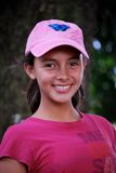 Beautiful Hispanic pre-teen. Smiling.  Pretty in pink Royalty Free Stock Images