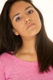 Beautiful Hispanic teen girl portrait with her head tilted to on Stock Photo