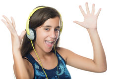 Beautiful hispanic teenager listening to music Stock Photos