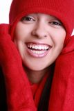 Beautiful hispanic woman. A pretty hispanic woman wearing a red hat and scarf royalty free stock image