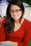 Beautiful Hispanic woman. Smiling outside in a beautiful garden Stock Photo