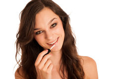 Beautiful hispanic woman aplying lip gloss Stock Photo