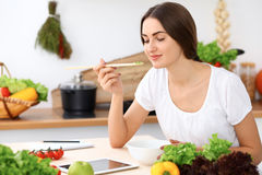 Beautiful  Hispanic woman is cooking in the kitchen Royalty Free Stock Image