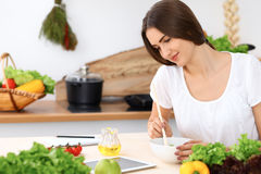 Beautiful  Hispanic woman is cooking in the kitchen Stock Photography