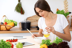 Beautiful  Hispanic woman is cooking in the kitchen Royalty Free Stock Images