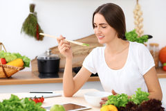 Beautiful  Hispanic woman is cooking in the kitchen Stock Images