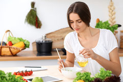 Beautiful  Hispanic woman is cooking in the kitchen Royalty Free Stock Photo