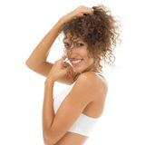 Beautiful hispanic woman with curly hair Royalty Free Stock Photos